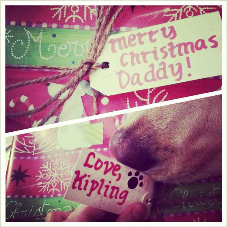Kipling wrapping her present to her daddy.